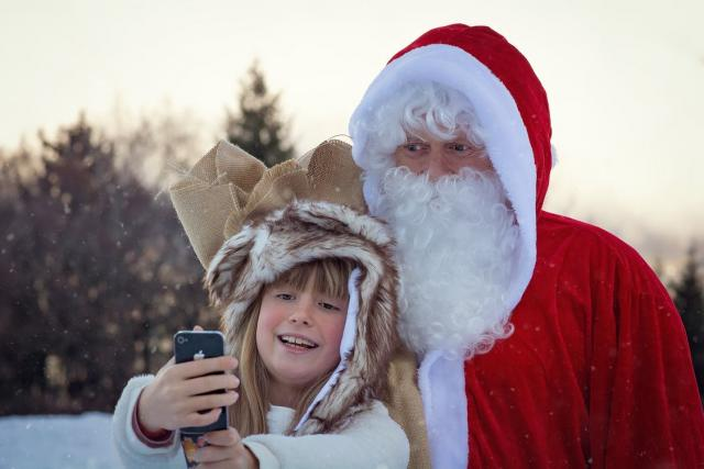 Santa taking selfie with little girl
